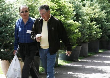 Rupert Murdoch (L), chairman and CEO of News Corporation, and David DeVoe, CFO of News Corp, go to lunch at the duck pond at the Sun Valley Inn in Sun Valley, Idaho July 8, 2009. REUTERS/Rick Wilking