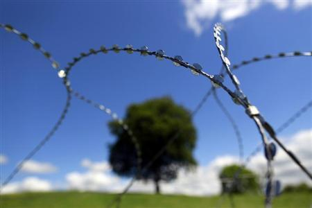Razor wire surrounds the Lough Erne Golf Resort in County Fermanagh where the G8 summit is being held next week, June 12, 2013 REUTERS/Cathal McNaughton