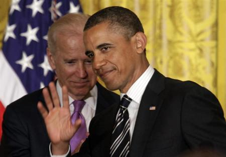 U.S. President Barack Obama (R) waves to Vice President Joe Biden at the LGBT Pride Month celebration at the White House in Washington June 13, 2013. REUTERS/Yuri Gripas