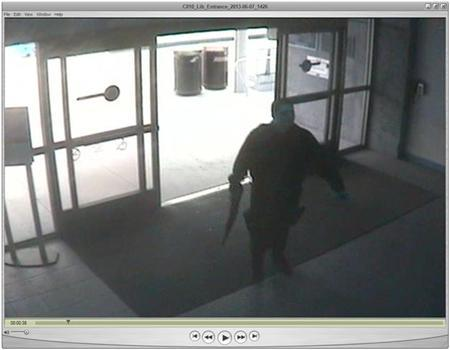 John Zawahri, a suspected gunman, enters the library at Santa Monica City College during the June 7, 2013 shooting incident in this handout still image from a surveillance camera video. REUTERS/Santa Monica Police/Handout via Reuters