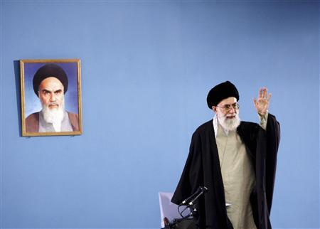 Iran's Supreme Leader Ayatollah Ali Khamenei gestures as he speaks to workers in Tehran in this April 26, 2006 file picture. REUTERS/IRNA