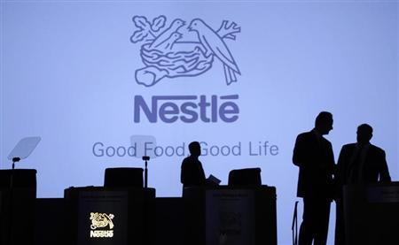 Members of the management of Swiss food maker Nestle arrive for the company's annual general meeting in Lausanne April 11, 2013. REUTERS/Denis Balibouse
