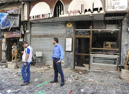 A view shows the site after bombs exploded close to a police post in the central Marjeh Square in Damascus June 11, 2013, in this handout photograph distributed by Syria's national news agency SANA. REUTERS/SANA/Handout via Reuters