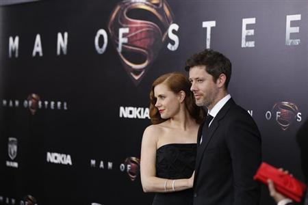 Cast member Amy Adams arrives with actor Darren Le Gallo for the world premiere of the film 'Man of Steel' in New York June 10, 2013. REUTERS/Lucas Jackson