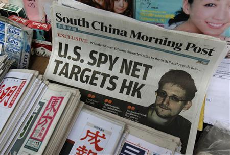 A copy of the South China Morning Post newspaper, carrying the latest interview of Edward Snowden, is displayed on a newspaper stand along with local Chinese newspapers in Hong Kong June 13, 2013. REUTERS/Bobby Yip