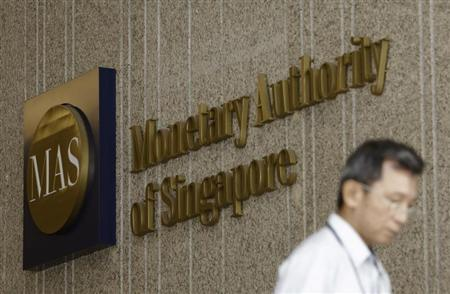 A man leaves the premises of the Monetary Authority of Singapore in the central business district of Singapore January 18, 2013. Picture taken January 18, 2013. REUTERS/Edgar Su