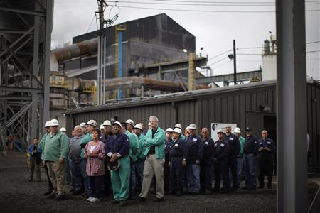 Steelworkers wait to meet U.S. President Barack Obama during a change of shift at V&M Star, in Youngstown, Ohio in this taken May 18, 2010 file picture. REUTERS/Jason Reed/Files
