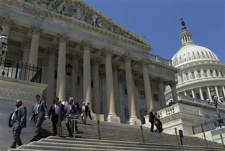Members of the House of Representatives and their staffs leave the U.S. Capitol in Washington on April 26, 2013. REUTERS/Gary Cameron