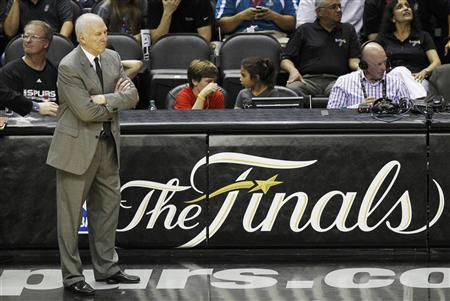 San Antonio Spurs head coach Gregg Popovich watches his team play the Miami Heat during the fourth quarter in Game 4 of their NBA Finals basketball series in San Antonio, Texas June 13, 2013. REUTERS/Mike Stone