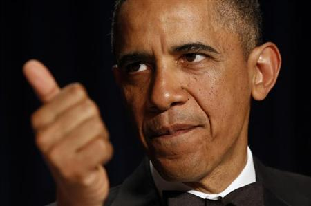 U.S. President Barack Obama gestures at the White House Correspondents Association Dinner in Washington April 27, 2013. REUTERS/Kevin Lamarque