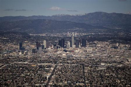 The Los Angeles skyline and the San Gabriel Mountains are seen in this aerial photo taken on February 20, 2013. Picture taken on February 20. REUTERS/Adrees Latif