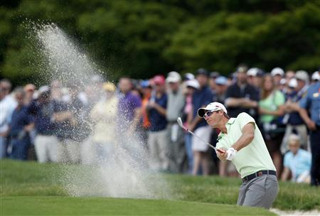 Belgium's Nicolas Colsaerts hits from a sand trap to the first green during the second round of the 2013 U.S. Open golf championship at the Merion Golf Club in Ardmore, Pennsylvania, June 14, 2013. REUTERS/Matt Sullivan