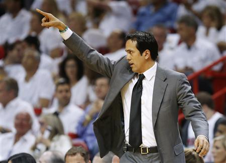 Miami Heat head coach Erik Spoelstra directs his team against the San Antonio Spurs during the first quarter in Game 2 of their NBA Finals basketball playoff in Miami, Florida June 9, 2013. REUTERS/Mike Segar