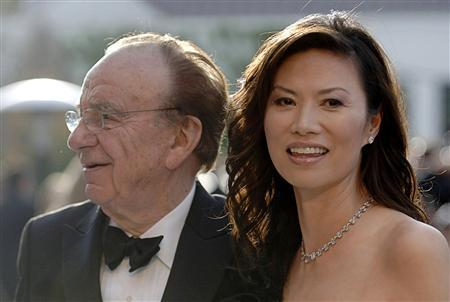 Rupert Murdoch and wife Wendi Deng arrive at the Vanity Fair Oscar Party at Mortons in West Hollywood in this March 5, 2006 file photo. REUTERS/Phil McCarten/Files