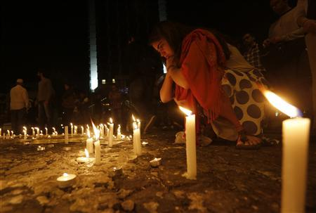 Protesters light candles in memory of victims of the recent violent anti-government protests in Turkey in Istanbul's Taksim square June 14, 2013. REUTERS/Yannis Behrakis