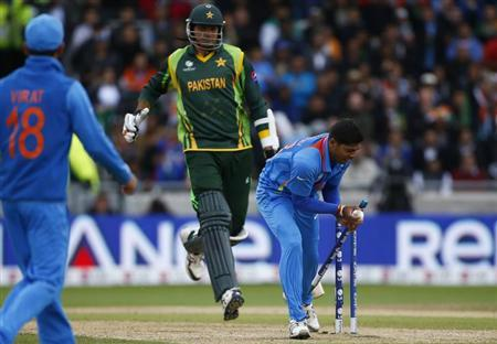 India's Umesh Yadav (R) runs out Pakistan's Mohammad Irfan during their ICC Champions Trophy group B match at Edgbaston cricket ground in Birmingham, central England, June 15, 2013. REUTERS/Darren Staples
