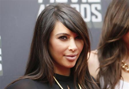 Socialite Kim Kardashian arrives at the 2013 MTV Movie Awards in Culver City, California April 14, 2013. REUTERS/Danny Moloshok