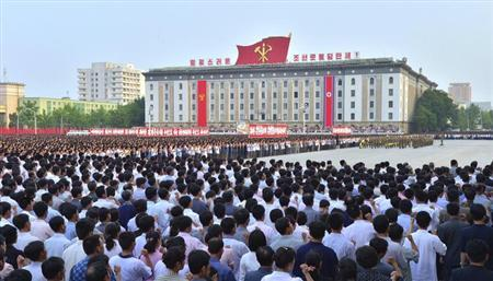 People attend a mass rally at Kim Il Sung Square in Pyongyang, in this photo released by North Korea's Korean Central News Agency (KCNA) on June 14, 2013. REUTERS/KCNA