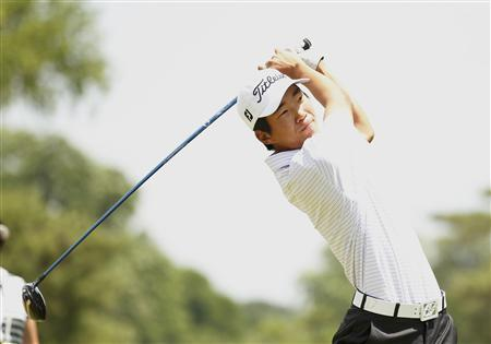 Amateur Michael Kim of the U.S. tees off on the second hole during the third round of the 2013 U.S. Open golf championship at the Merion Golf Club in Ardmore, Pennsylvania, June 15, 2013. REUTERS/Adam Hunger