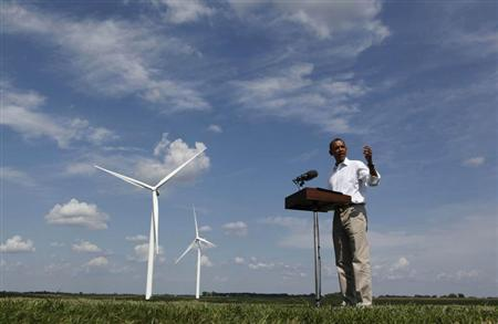 U.S. President Barack Obama talks to the media on the Heil Family Farm, a wind farm, in Haverhill, Iowa, August 14, 2012. REUTERS/Larry Downing