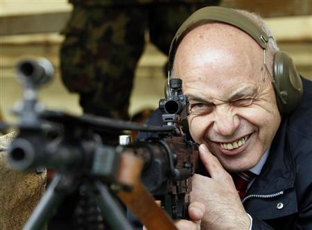 Swiss President Ueli Maurer aims at a target at 300 metres (984.25 feet) distance during a shooting exercise together with the Foreign Diplomatic Corps in Switzerland during the 'Eidgenoessisches Feldschiessen' in St Ursen near Fribourg May 31, 2013. REUTERS/Denis Balibouse