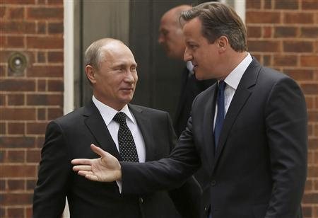 Britain's Prime Minister David Cameron (R) greets Russia's President Vladimir Putin in Downing Street, in central London June 16, 2013. REUTERS/Luke MacGregor