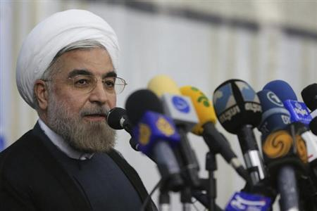 Iranian President-elect Hassan Rohani speaks to the media following a visit to the Khomeini mausoleum in Tehran June 16, 2013. Reuters/Fars News/Seyed Hassan Mousavi