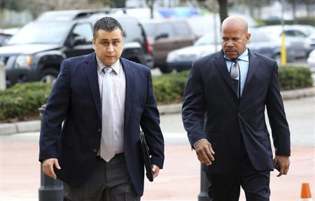 George Zimmerman is escorted by a private security guard as he arrives for a hearing in Sanford, Florida, December 11, 2012. REUTERS/Joe Burbank/Orlando Sentinel/POOL