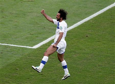 Italy's Andrea Pirlo celebrates after scoring against Mexico during their Confederations Cup Group A soccer match at the Estadio Maracana in Rio de Janeiro June 16, 2013. REUTERS/Sergio Moraes