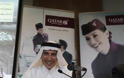 Chief Executive of Qatar Airways Akbar Al Baker laughs during the Arabian Travel Market at Dubai International Convention and Exhibition Centre in Dubai, May 6, 2013. REUTERS/Jumana El Heloueh