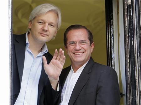 WikiLeaks founder Julian Assange waves from a window with Ecuador's Foreign Affairs Minister Ricardo Patino (R) at Ecuador's embassy in central London June 16, 2013. REUTERS/Chris Helgren