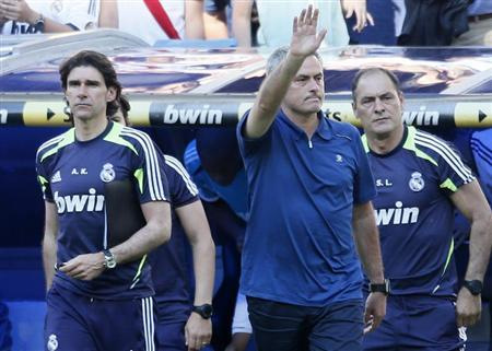Real Madrid coach Jose Mourinho gestures after their Spanish first division soccer match against Osasuna at Santiago Bernabeu stadium in Madrid June 1, 2013. REUTERS/Javier Barbancho