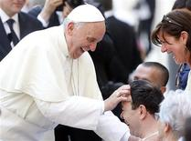 Pope Francis blesses a sick man after a mass in Saint Peter's Square at the Vatican June 16, 2013. REUTERS/Stefano Rellandini