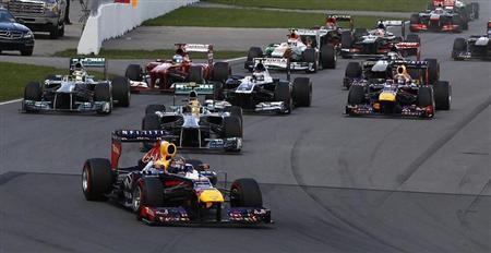 Drivers take a corner during the Canadian F1 Grand Prix at the Circuit Gilles Villeneuve in Montreal June 9, 2013. REUTERS/Chris Wattie