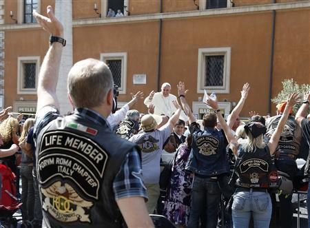 Pope Francis blesses the Harley Davidson bikers from his Popemobile before the start of a mass outside Saint Peter's Square in Rome June 16, 2013. REUTERS/Stefano Rellandini