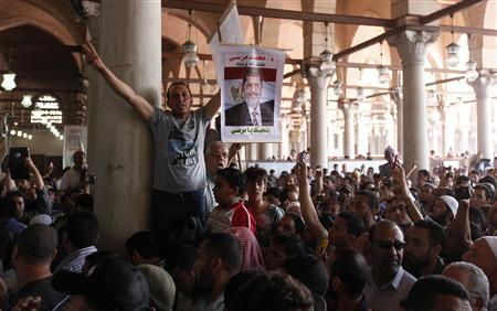 Supporters of Egyptian President Mohamed Mursi shout slogans during protest in support of Syrian rebels in Amr Bin Aaas mosque in Cairo June 14, 2013.'' REUTERS/Mohamed Abd El Ghany