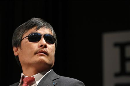 Chinese dissident Chen Guangcheng speaks to journalists following an appearance in New York in this May 3, 2013 file photo. REUTERS/Brendan McDermid/File