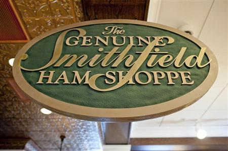 A sign advertising Smithfield hams hangs at the Taste of Smithfield restaurant and gourmet market in Smithfield, Virginia May 30, 2013. REUTERS/Rich-Joseph Facun