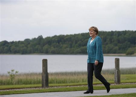 Germany's Chancellor Angela Merkel arrives at the Lough Erne golf resort where the G8 summit is taking place in Enniskillen, Northern Ireland June 17, 2013. REUTERS/Suzanne Plunkett