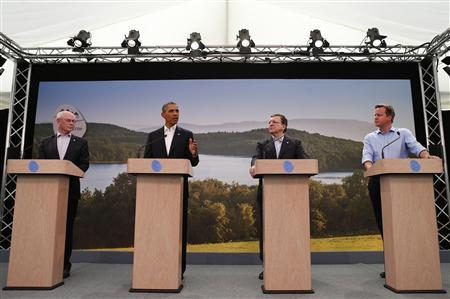 U.S. President Barack Obama (2nd L) attends a news conference with (L-R) European Council President Herman Van Rompuy, European Commission President Jose Manuel Barroso and Britain's Prime Minister David Cameron at the G8 summit in Enniskillen, Northern Ireland June 17, 2013. REUTERS/Andrew Winning