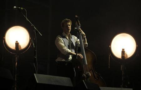 Bass player Ted Dwane performs with his band Mumford and Sons on the main stage during the 2nd day of the Coachella Valley Music & Arts Festival in Indio, California April 16, 2011. REUTERS/Mike Blake