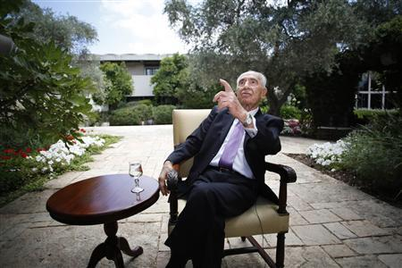 Israel's President Shimon Peres gestures as he speaks during an interview with Reuters at his residence in Jerusalem June 16, 2013. REUTERS/Baz Ratner