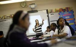 Teacher Jaclyn Kruljac speaks to her students in 5th grade class at Walsh Elementary School in Chicago, Illinois, March 1, 2013. REUTERS/Jim Young
