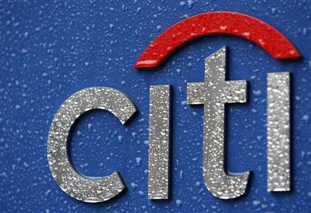 Raindrops are pictured on a signboard of Citibank at its branch in Tokyo, February 23, 2009. REUTERS/Kim Kyung-Hoon
