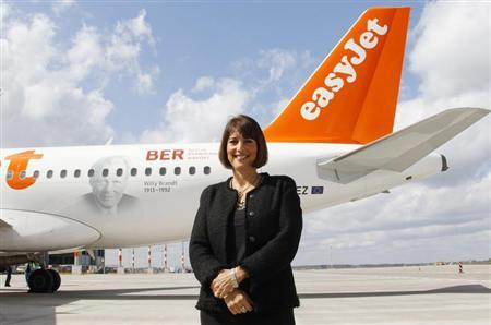 Carolyn McCall, Chief Executive Officer of easyJet poses for the media during a name giving ceremony for an easyJet Airbus A320 'Willy Brandt' at the terminal of the future Berlin Brandenburg international airport Willy Brandt (BER) in Schoenefeld, outside Berlin, April 23, 2012. REUTERS/Fabrizio Bensch