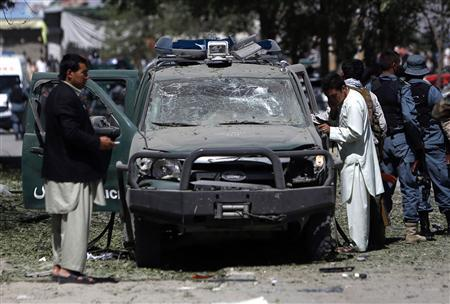 Afghan security forces personnel investigate the site of an explosion in Kabul June 18, 2013. REUTERS/Mohammad Ismail