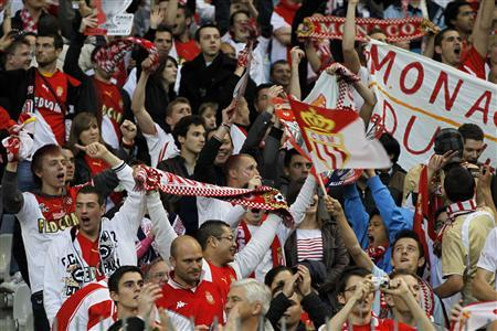 Monaco's fans cheer their team during the French Cup final football match against Paris Saint-Germain at the Stade de France in Saint-Denis, in this May 1, 2010 file photo. REUTERS/Charles Platiau/Files