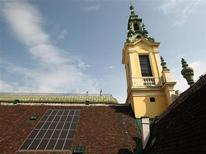 Solar panels are pictured on the roof of the Protestant Reformed Church in Vienna April 9, 2013. REUTERS/Heinz-Peter Bader