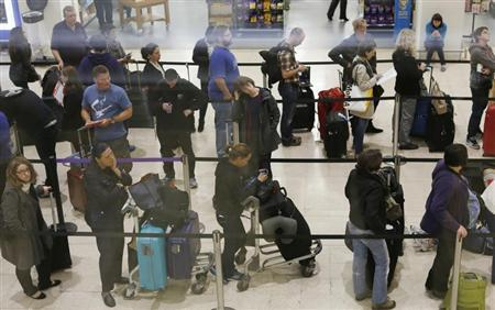 British Airways passengers queue for customer services after flights were delayed and cancelled at Heathrow in London May 24, 2013. REUTERS/Olivia Harris