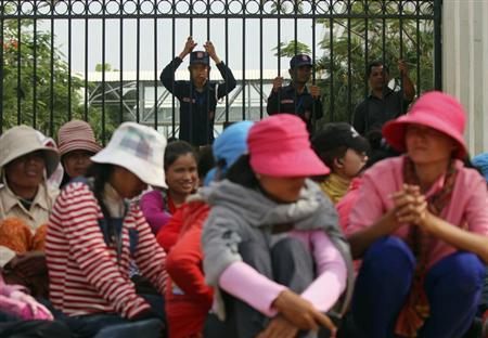 Workers gather during their strike in front of a factory owned by Sabrina (Cambodia) Garment Manufacturing in Kampong Speu province, west of the capital, Phnom Penh May 30, 2013. REUTERS/Samrang Pring
